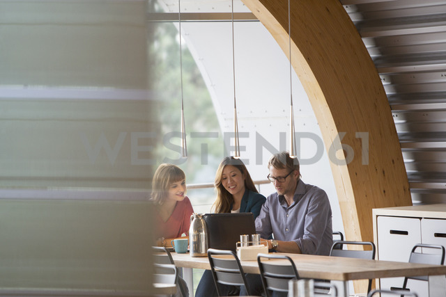 Business people talking in cafeteria - CAIF14938
