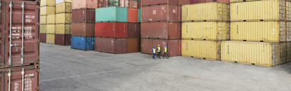 Workers walking near cargo containers - CAIF15109