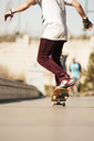 Low section of man skateboarding at park - CAVF06257