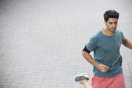 Man running through city streets - CAIF15158