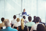 Young businesswoman giving presentation in conference room - CAIF15263