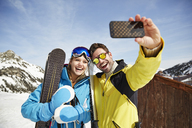 Couple taking picture together in the snow - CAIF15287