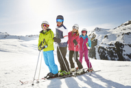 Family skiing on mountain top - CAIF15371