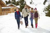Family walking through snow together - CAIF15395