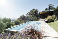 Modern house exterior with large swimming pool - CAIF15512