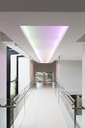 Empty corridor in modern building with colored lighting above - CAIF15533