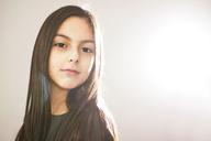 Portrait of girl standing against wall - CAVF07061