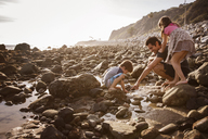 Father with children enjoying at beach during sunset - CAVF07118