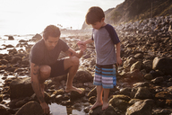 Father and son at beach during sunset - CAVF07124