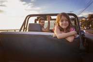Portrait of happy girl with father in pick-up truck - CAVF07151