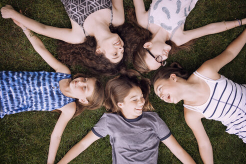 High angle view of friends lying on grass - CAVF07253