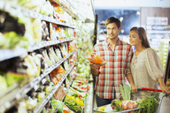 Couple shopping together in grocery store - CAIF15569