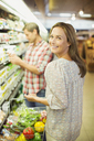 Couple shopping together in grocery store - CAIF15605