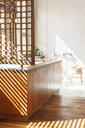 Blinds casting shadows in modern bathroom - CAIF15632