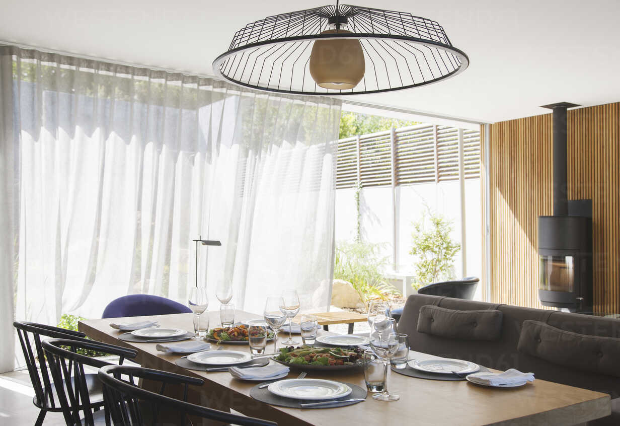 Chandelier Over Dining Table In Modern Dining Room Caif15635 Astronaut Images Westend61