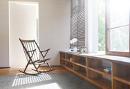 Rocking chair and rug in modern bedroom - CAIF15638