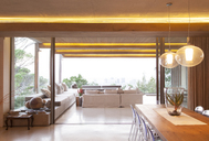 Sliding glass doors between open modern living and dining rooms - CAIF15644