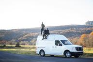 Friends on camper van against clear sky - CAVF07833