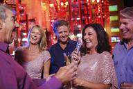 Friends singing karaoke in nightclub - CAIF15866