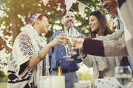 Friends toasting champagne glasses at birthday party - CAIF16085