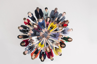 Portrait of confident business people in huddle - CAIF16199