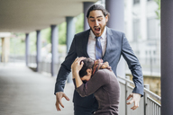 Businessman screaming at woman - JSCF00062