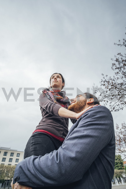 Low angle view of woman above businessman - JSCF00080