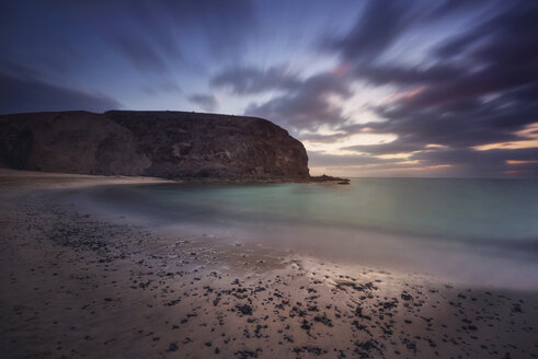Spain, Canary Islands, Lanzarote, Papagayo beach at dusk - DHCF00181