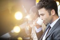 Businessman at sidewalk cafe - CAIF16312