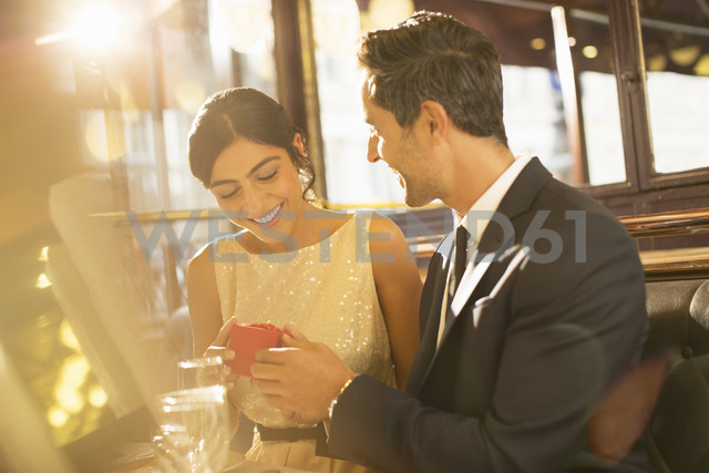 Man proposing to girlfriend in restaurant - CAIF16345