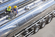Workers on top of stainless steel milk tanker - CAIF16402