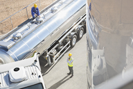 Workers around stainless steel milk tanker - CAIF16420