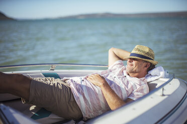 Older man relaxing in boat on water - CAIF16645