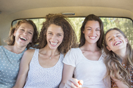 For women sitting in car backseat together - CAIF16762