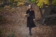 Woman with basket walking in road - CAVF08309
