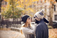 Woman holding boyfriend while puckering - CAVF08351