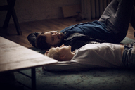 Couple relaxing on floor at home - CAVF08429