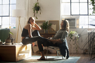 Side view of couple sitting at home - CAVF08570