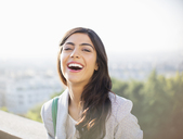 Woman laughing outdoors - CAIF16902
