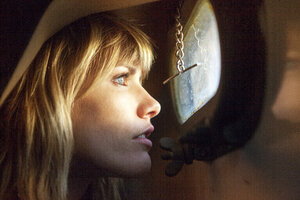 Close-up woman looking through window at yacht - CAVF08918