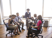 High angle view of business people in meeting at office - CAVF08945