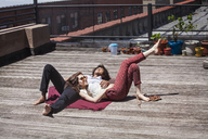 Couple relaxing at building terrace - CAVF09029