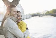 Couple hugging along Seine River, Paris, France - CAIF17050