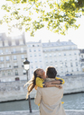 Couple hugging along Seine River, Paris, France - CAIF17053
