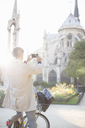 Man photographing Notre Dame Cathedral, Paris, France - CAIF17071