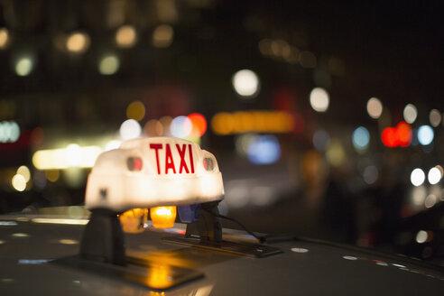 Close up of illuminated Parisian taxi light, Paris, France - CAIF17074