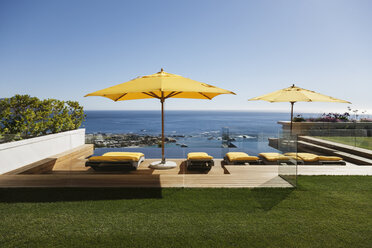 Lounge chairs overlooking infinity pool and ocean - CAIF17092