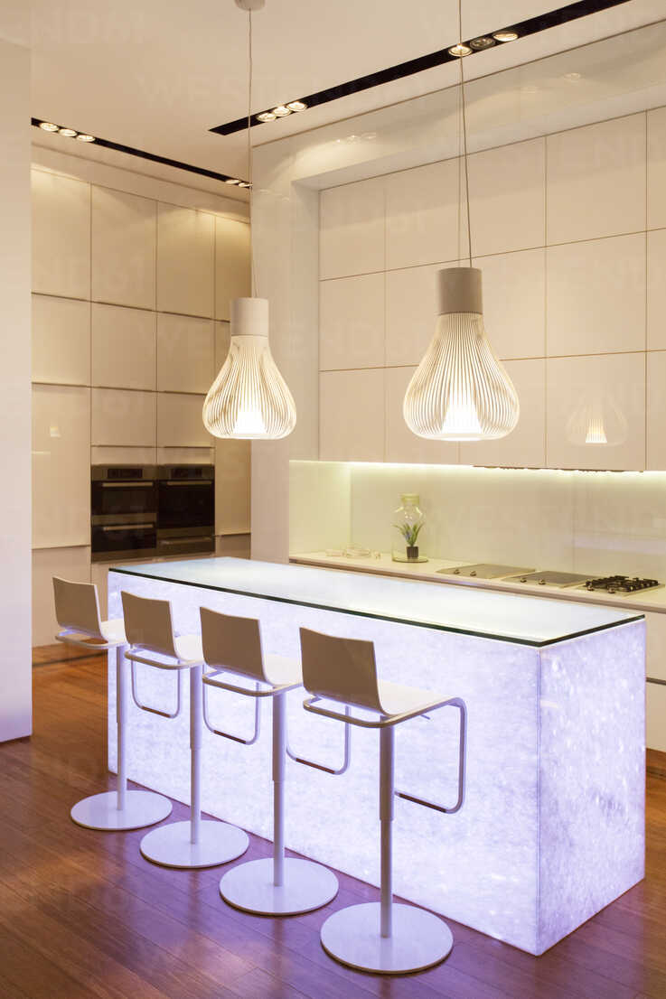 Bar stools and light features in modern kitchen - CAIF17161 - Astronaut Images/Westend61