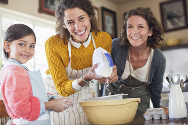 Three generations of women baking together - CAIF17258