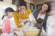 Three generations of woman baking together - CAIF17273
